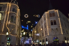 Illuminated Old Street with a glimpse of the Ljubljana Castle, December 2014