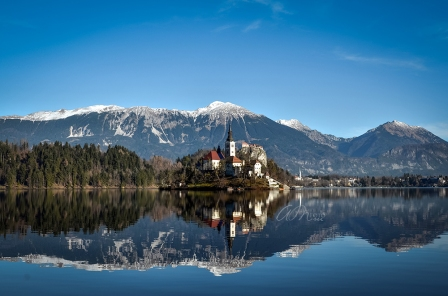 Beautiful Church of the Assumption reflecting in Lake Bled, Slovenia