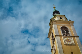 Looking up the Bell Tower of St-Nicholas Church in Ljubljana, Slovenia
