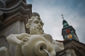 Beautiful Fountain of Robba with glimpse of a Church in Ljubljana, Slovenia
