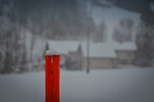 Lonely Red Pole during a Snowstorm in Slovenia
