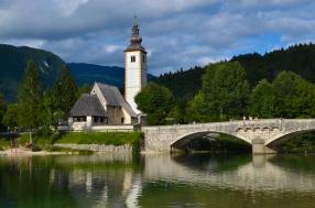 Beautiful Church of St. John the Baptist and Bridge at Lake Bohinj